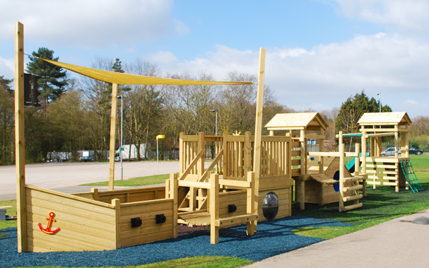 Playground apparatus with wooden ship