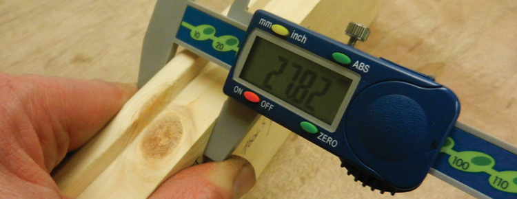 Precise measuring tool being used on planed timbers